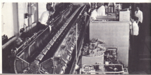 Fig. 47.9. Proton linear accelerator with vacuum tank cover removed showing drift tubes. This accelerator was in use at the Rutherford Laboratory, Chilton until the middle 60s. At present, accelerators like this are used for injecting protons into synchrotrons