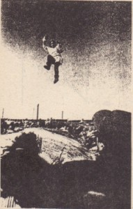 In olden days, a native Alaskan would be tossed via a blanket to be able to see farther over the flat terrain. Nowadays, it is done just for fun. During the ascent of the child in the photograph