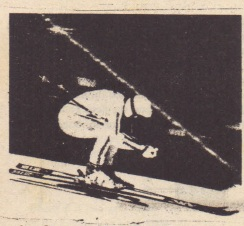 """6Th;s skier7rouches in an """"egg """"position"""" so as to minimize her effective cross-sectional area and thus the air drag acting on her."""
